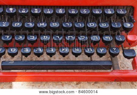 Vintage typewriter with Hebrew letters