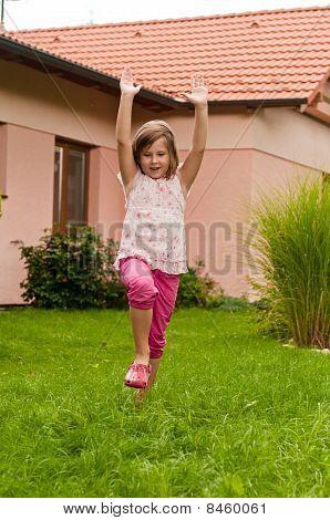 Cartwheel  - Girl In Backyard