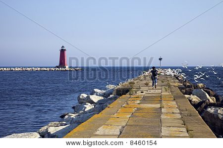 Tourist Running On The Pier