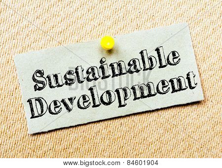 Recycled Paper Note Pinned On Cork Board. Sustainable Development Message