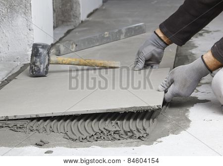 Home Improvement, Renovation - Construction Worker Tiler Is Tiling, Ceramic Tile Floor Adhesive, Tro