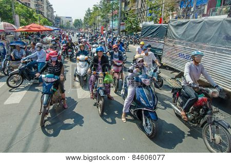 Motorcycles crowd city streets in Saigon