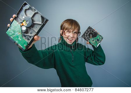 European appearance teenager boy with big glasses in a long gree