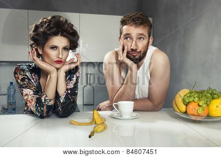 Funny Couple After Breakfast. Strange Faces. Young Man And Beauty Woman In Kitchen