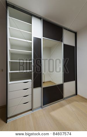 Closet With Sliding Doors, Drawer And Shelves