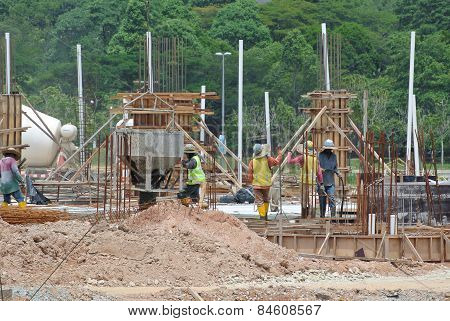 Group of construction workers casting for ground floor slab