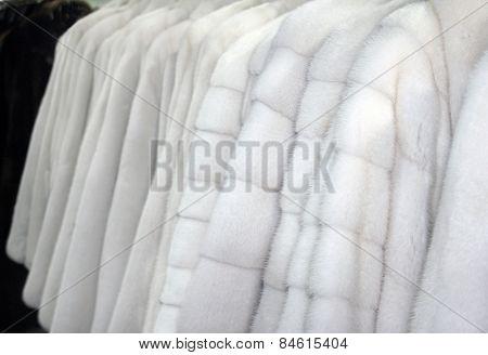Row of many fur coats