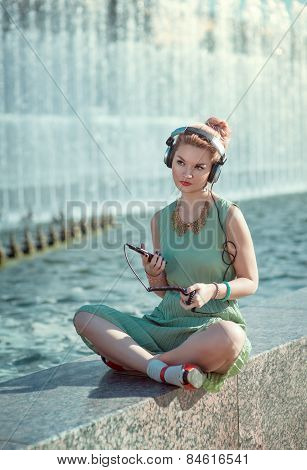 Hipster Fashion Hipster Girl In Green Dress Listening Music