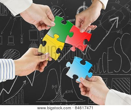 Group Of Business People Assembling Colorful Jigsaw Puzzles