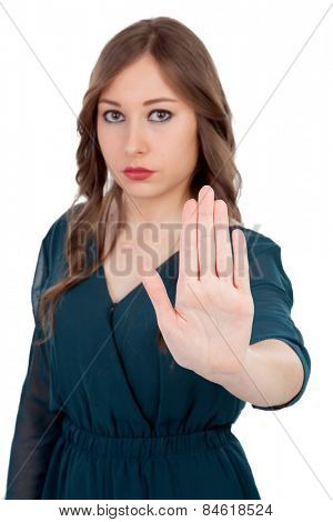 Serious woman asking to stop with the focus on the hand isolated on a white background