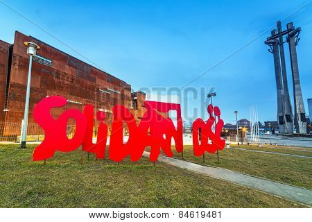GDANSK, POLAND - FEBRUARY 21, 2015: Solidarnosc sign under European Solidarity Centre in Gdansk, Poland. The ECS museum located at the docyard is a memorial of anti-communist opposition in Poland.