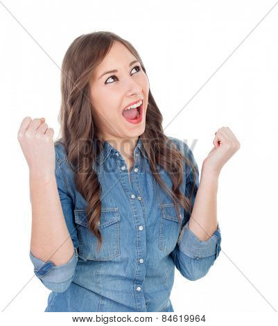 Happy young woman celebrating something isolated on a white background