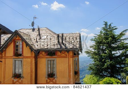 Wooden House Against The Como Lake Landscape