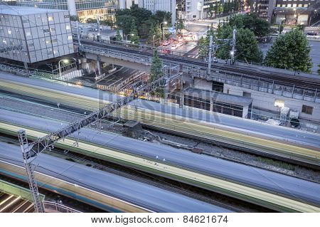 Speeding trains rush past a section of railway line