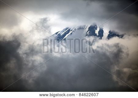 Mount Fuji hides behind the clouds