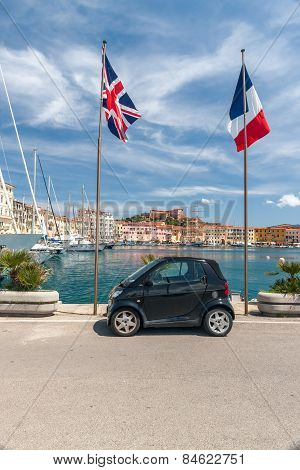 small car on the waterfront of Porto Azzurro, Italy