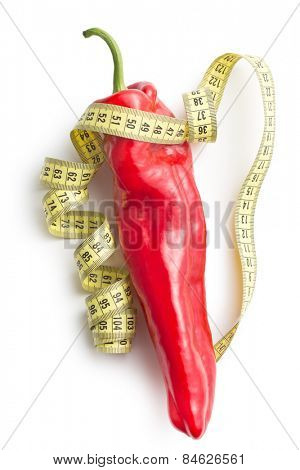 red pepper and measuring tape on white background