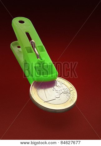 One Euro Coin In Green Clothespin Maw