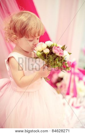Cute funny baby girl is in the suit of princess
