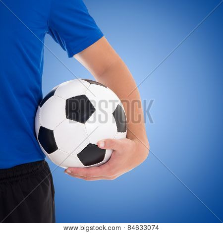 Soccer Ball In Player's Hand Over Blue