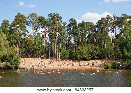 People Swimming In Moskva River At Serebryany Bor Park