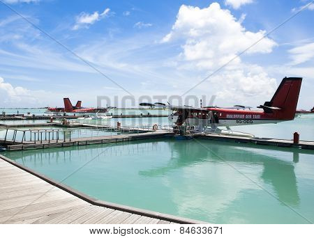 MALE, MALDIVES - SEPTEMBER 07 2008: Twin otter red seaplane Hydroplane at Male airport