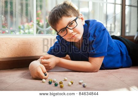 Tween Playing With Marbles
