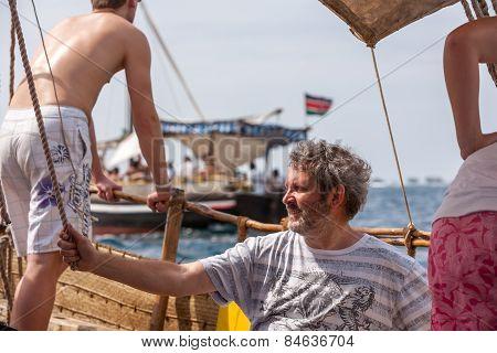 Tourists enjoying sea on yacht. Ship traveling in Kenya