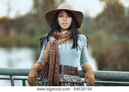 Portrait Of  Girl In A Hat And Scarf On The Bridge
