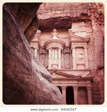 The ancient Treasury of Petra, Jordan, processed and filtered to look like an aged instant photo.