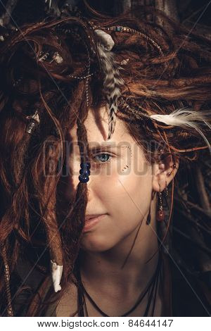 Close up Face of Pretty Young Female with Tangled Dreadlocks Blond Hair Looking at the Camera.