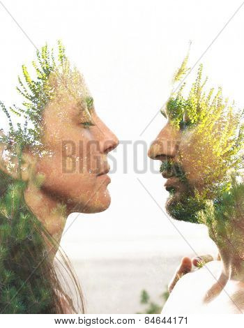 Double exposure portrait of a couple combined with photograph of greenery