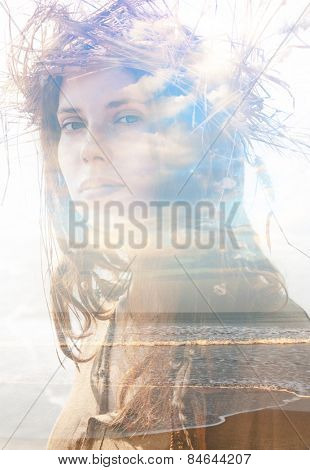 Double exposure portrait of a girl with wreath combined with photograph of a beach