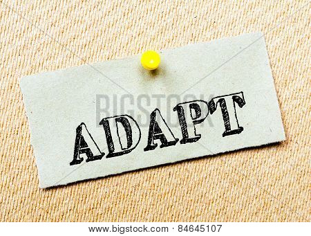 Recycled Paper Note Pinned On Cork Board. Adapt Message. Concept Image