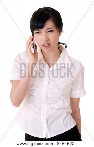 Worried business woman holding cellphone and listening, closeup portrait of Asian businessperson on white background.