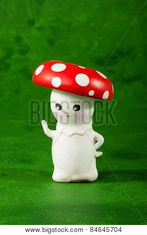 cute puppet handmade, one mushroom, green background