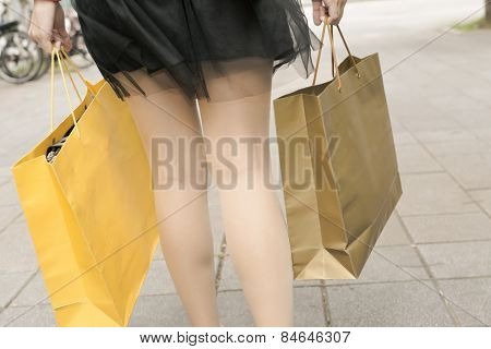 Shopping woman walk on street in Xinyi district, the business and commercial center in Taipei, Taiwan, Asia. Closeup image focus on foot.