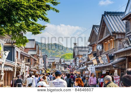 ISE, JAPAN - APRIL 25, 2014: Crowds walk on the historic shopping street of Oharai-machi. The reconstructed buildings are completed in the Edo period traditional style.