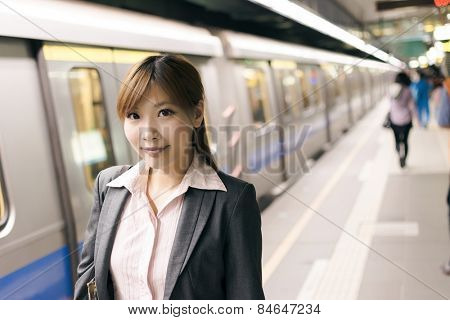 Asian young business woman in the MRT station, shot at Xinyi business district, Taipei, Taiwan.