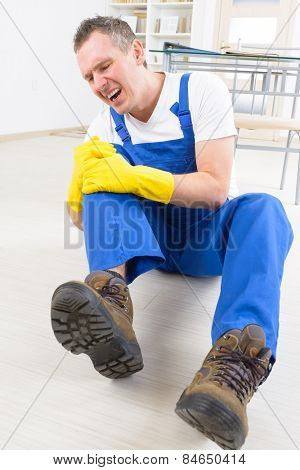 Man worker with knee injury, concept of accident at work