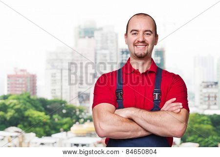 smiling manual worker an city background