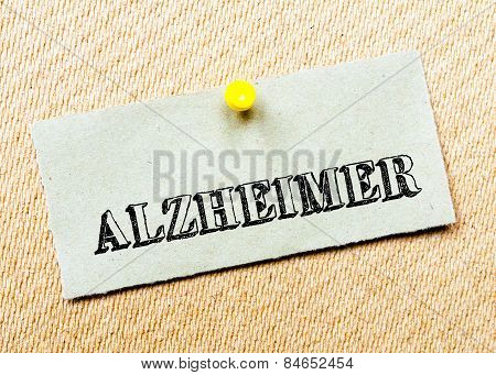 Recycled Paper Note Pinned On Cork Board. Alzheimer Message. Concept Image