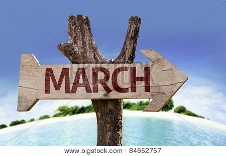 March sign with beach background