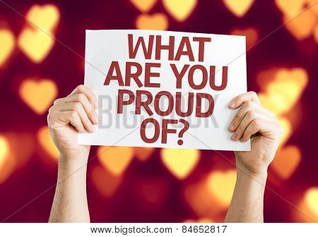 What Are You Proud Of? card with heart bokeh background