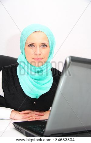 Beautiful Young Muslim Business Woman With Laptop In Office