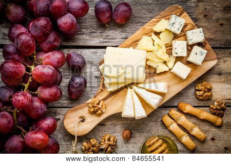 Cheese Plate: Emmental, Camembert Cheese, Blue Cheese, Bread Sticks, Walnuts, Hazelnuts, Honey, Grap