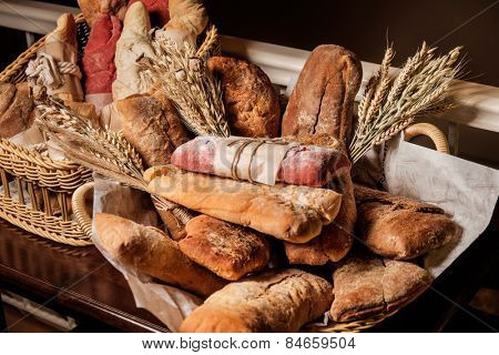 variety of bread, ciabatta, grissini, malted and beet bread