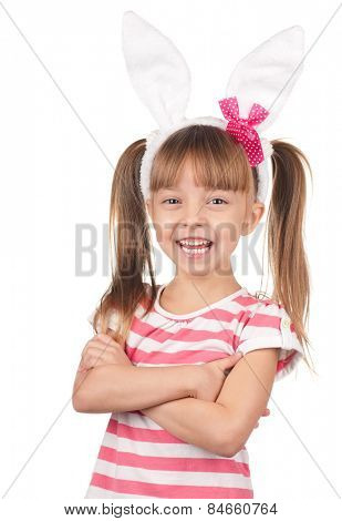 Easter concept image. Portrait of happy little girl with bunny ears over white background.
