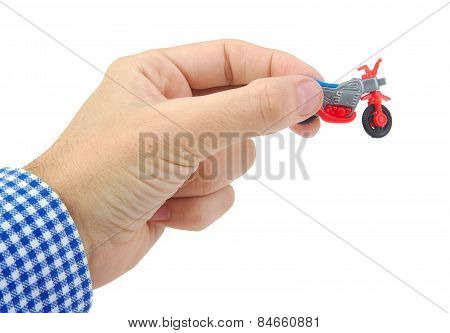 Man hand holding a plastic bicycle toy on white background