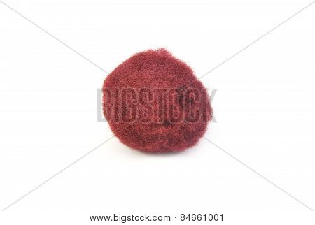 Ball of brown cotton on white background